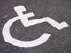disabled parking sign on road