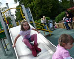 children playing on a slide and climbing frame