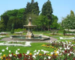 Formal park with trees, flower beds and a fountain