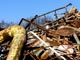 rusting scrap heap against blue sky