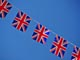 Union jack bunting with blue sky in background