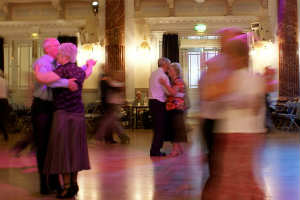 Three older couples dancing at a tea dance at Cheltenham's town hall