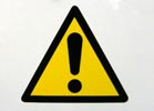 caution sign - black triangle and exclamation mark on yellow background