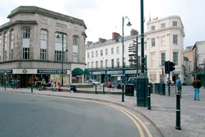 Photograph of Boots corner, taken from in front of Boots looking towards Starbucks