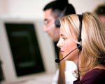 Customer service officers wearing telephone head-sets