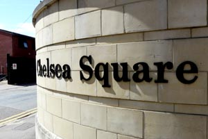 Chelsea Square lettering on a rounded stone wall