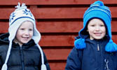 two smiling boys wearing woolly hats