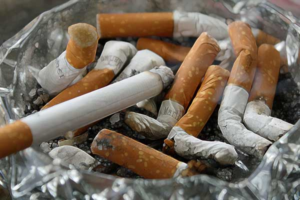 Used cigarettes in an ash tray
