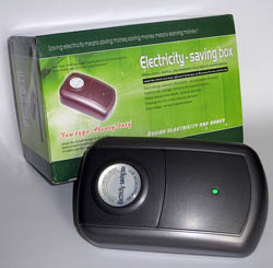"Rectangular black plastic device next to green box. Box and device display the words ""energy-saving box"""
