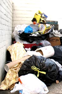 bags of rubbish and other items dumped on the street