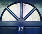 Close-up of a front door with a fanlight window and the number 17