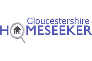 Glouucester Homeseeker logo in purple letters. The O in Homeseeker is formed from a magnifying glass held over a cartoon picture of a house.