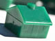 green plastic Monopoly house