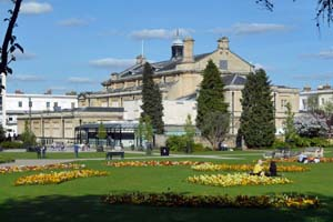 View of Imperial Gardens in the sun, with the town hall in the background