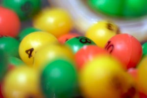 red, green and yellow numbered lottery balls