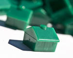 green plastic toy houses
