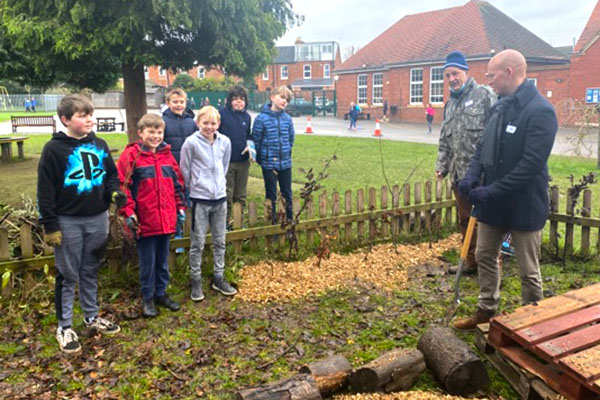 Council officers and school children planting trees for schoos