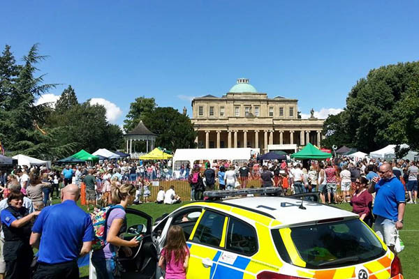 Wide shot of Pittville Lawn during Paws in the Park, showing police and market stalls