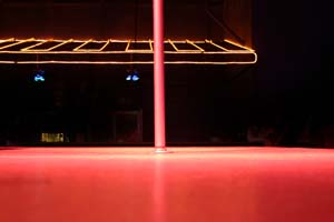 An empty pole on a stage in a club