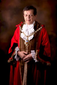 Councillor Roger Whyborn in red mayoral robes and gold chain