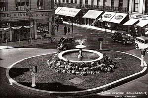 Black and white photo of roundabout in cheltenham from years gone by