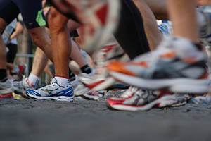 close-up of runners' feet on tarmac