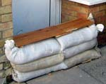 Sandbags protecting a door - credit tamadhanaval flickr, https://www.flickr.com/photos/tamf/