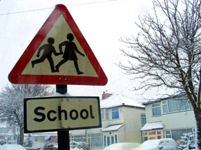 red and white triangular road sign - warning school