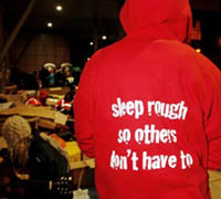 A picture of the back of a person who is wearing a red pullover promoting the Sleep Easy event
