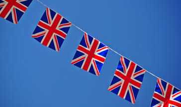 red, white and blue Union Jack bunting against bright blue sky