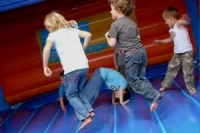 Children having fun on a bouncy castle