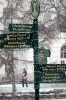 snow falling around the twinning sign