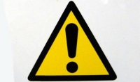 caution sign - black triangle and exclamation mark on yellow back
