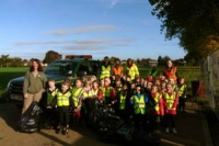 Pupils from year one at Rowanfield Infant School with Ubico staff and community ranger
