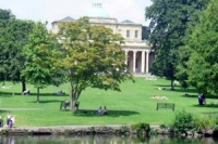 View looking over the upper lake in Pittville Park towards the pump room