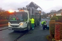 Refuse and recycling vehicle on collection round with the crew