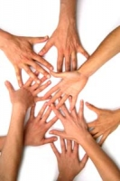 Hands together in a group