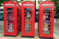 Red phoneboxes on the Promenade with the '300 years a spa' art installation