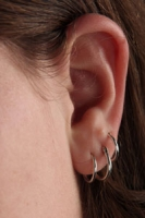 Three ear piercings