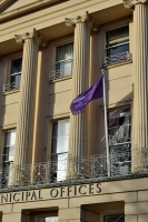 Purple flag flying outside the muni