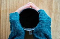 Coffee cup warming hands