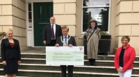 Mayor presents cheque to charity representatives