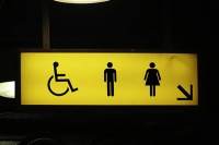 Image of yellow sign indicating location of public toilets