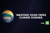 Picture of Earth overlaid with a rotting orange, with text to the right which reads 'wasting food feeds climate change'