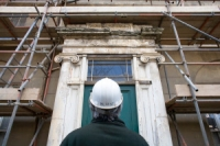 a builder surveying a building