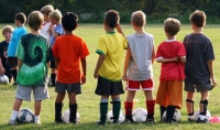children in colourful football strip
