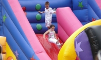 Kids playing on a bouncy castle